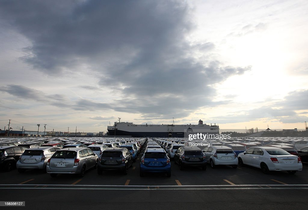 Toyota Motor Corp. cars including the Aqua hybrid compact cars sit parked ahead of shipping at the port in Sendai City, Miyagi Prefecture, Japan, on Friday, Dec. 14, 2012. Toyota Motor East Japan Inc. commenced operations at its Miyagi Taiwa plant today manufacturing engines for the Toyota Motor Corp. Aqua hybrid compact car. Photographer: Tomohiro Ohsumi/Bloomberg via Getty Images