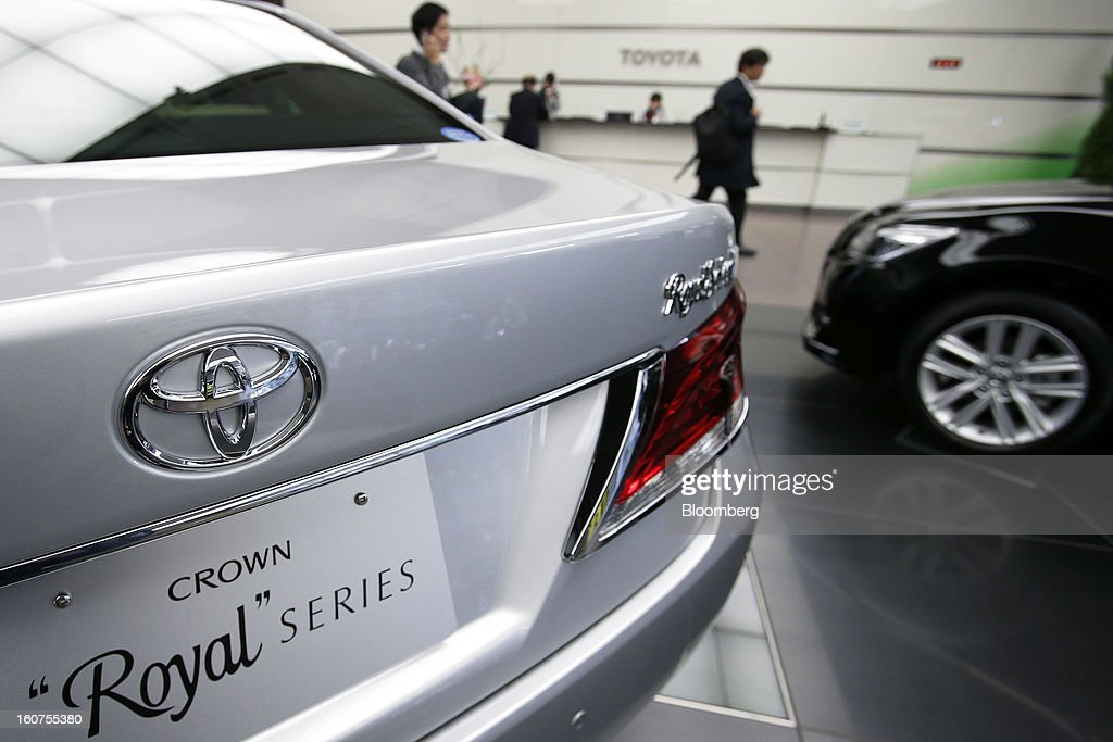 A Toyota Motor Corp. Crown Royal sedan stands on display at the company's headquarters in Tokyo, Japan, on Tuesday, Feb. 5, 2013. Toyota, the world's biggest carmaker, raised its profit forecast after the yen weakened more than any other currency, raising the value of Japanese cars sold overseas. Photographer: Kiyoshi Ota/Bloomberg via Getty Images