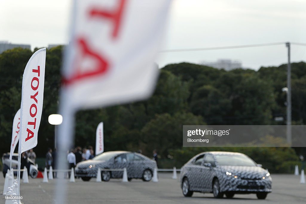 Toyota Motor Corp. fuel cell (FCV) prototype vehicles are test driven during a media briefing on the company's advanced technologies in Tokyo, Japan, on Thursday, Oct. 10, 2013. Toyota has long held out hydrogen as the ultimate alternative to gasoline for powering autos. Soon, consumers will be able to kick the tires of its fuel cell-powered car and those of other automakers. Photographer: Kiyoshi Ota/Bloomberg via Getty Images