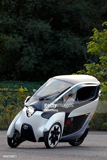 A Toyota Motor Corp iROAD electric personal mobility vehicle is test driven during a media briefing on the company's advanced technologies in Tokyo...