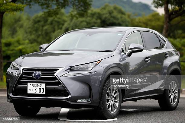 A Toyota Motor Corp Lexus brand NX 300h hybrid crossover sportutility vehicle stands on display during a media preview at the Toyota Motor Kyushu Inc...