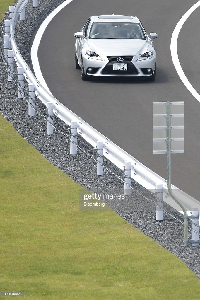 A Toyota Motor Corp. Lexus vehicle is driven on a test track at the company's Tajimi service center in Tajimi, Gifu Prefecture, Japan, on Monday, July 22, 2013. Toyota is the world's largest car maker. Photographer: Kiyoshi Ota/Bloomberg via Getty Images