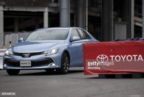 A Toyota Motor Corp Mark X sedan is taken for a test drive at the Toyota Mega Web showroom in Tokyo Japan on Tuesday Aug 1 2017 Toyota is scheduled...