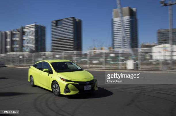 A Toyota Motor Corp Prius plugin hybrid vehicle known as Prius Prime in US is driven during a test drive ahead of its sales launch outside the...