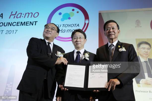 Toyota Motor Corp senior officer Keiji Yamamoto attends a signing ceremony with officials of Chulalongkorn University in Bangkok on Aug 3 for a...