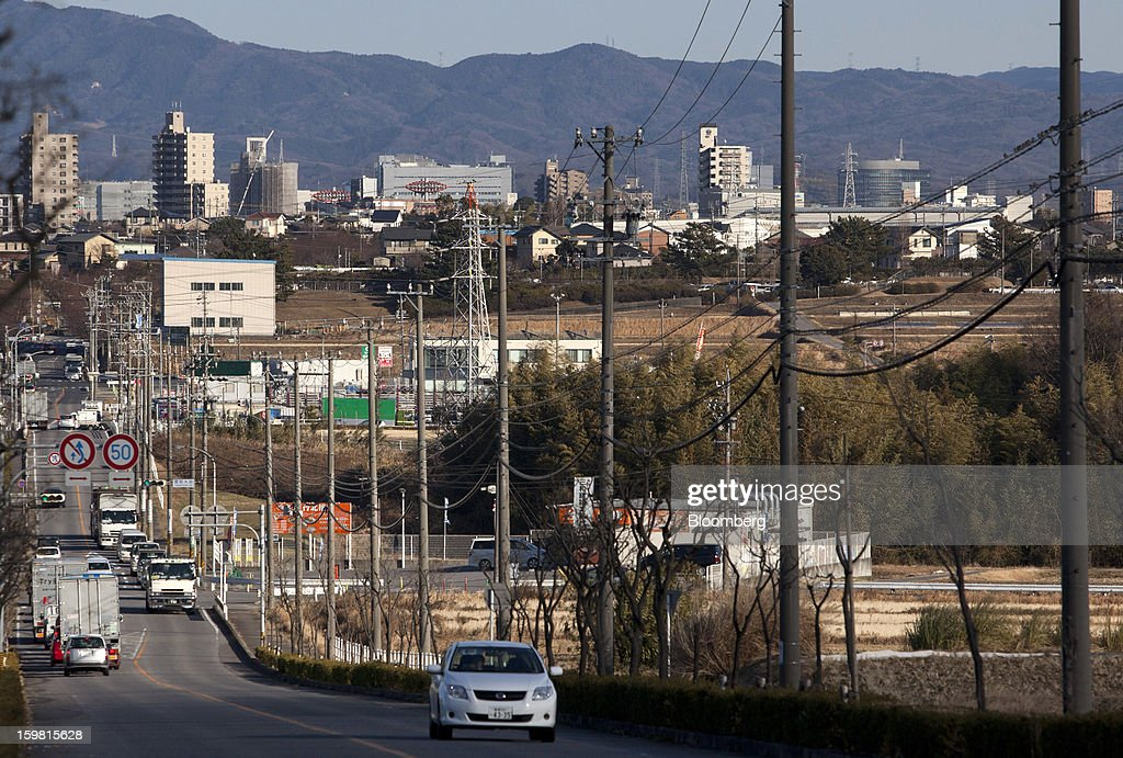 A Toyota Motor Corp. vehicle drives along a road in Toyota City, Aichi Prefecture, Japan, on Friday, Jan. 18, 2013. Toyota, poised to regain its title as the world's biggest carmaker this year, said last month its vehicle sales may rise 2 percent next year to a record, led by demand from overseas markets. Photographer: Tomohiro Ohsumi/Bloomberg via Getty Images