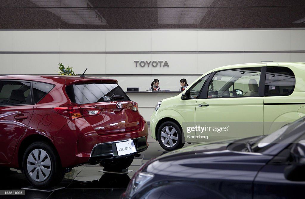 Toyota Motor Corp. vehicles are displayed at the company's head offices in Tokyo, Japan, on Monday, Nov. 5, 2012. Toyota Motor Corp., Asia's biggest carmaker, raised its full-year profit forecast as rising demand for the Prius hybrid in the U.S. and Japan helped make up for slumping sales in China. Photographer: Tomohiro Ohsumi/Bloomberg via Getty Images
