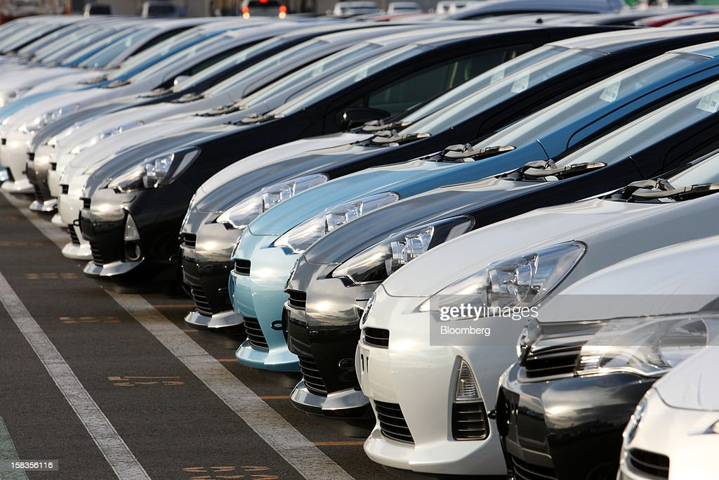 Toyota Motor Corp. vehicles including the Aqua hybrid compact car sit parked ahead of shipping at the port in Sendai City, Miyagi Prefecture, Japan, on Friday, Dec. 14, 2012. Toyota Motor East Japan Inc. commenced operations at its Miyagi Taiwa plant today manufacturing engines for the Toyota Motor Corp. Aqua hybrid compact car. Photographer: Tomohiro Ohsumi/Bloomberg via Getty Images