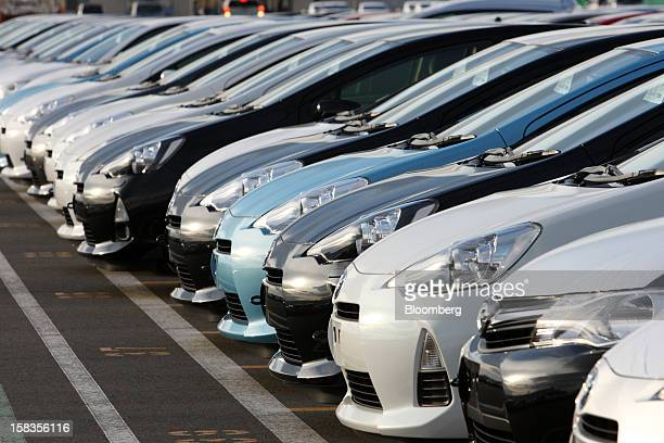 Toyota Motor Corp vehicles including the Aqua hybrid compact car sit parked ahead of shipping at the port in Sendai City Miyagi Prefecture Japan on...