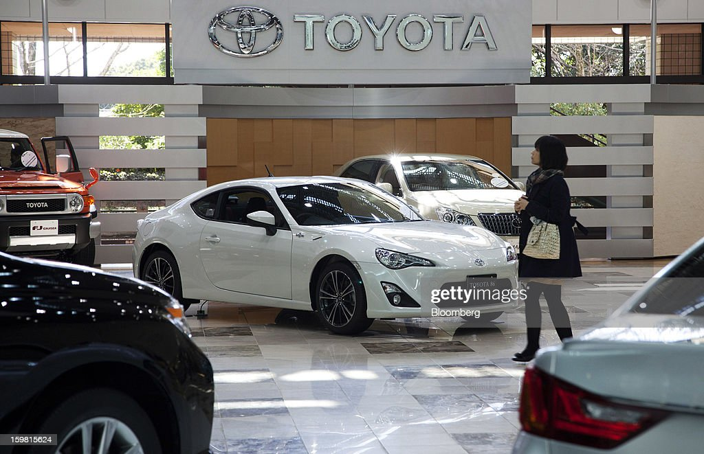 Toyota Motor Corp. vehicles stand in the showroom at the company's headquarters in Toyota City, Aichi Prefecture, Japan, on Friday, Jan. 18, 2013. Toyota Motor Corp., poised to regain its title as the world's biggest carmaker this year, said last month its vehicle sales may rise 2 percent next year to a record, led by demand from overseas markets. Photographer: Tomohiro Ohsumi/Bloomberg via Getty Images