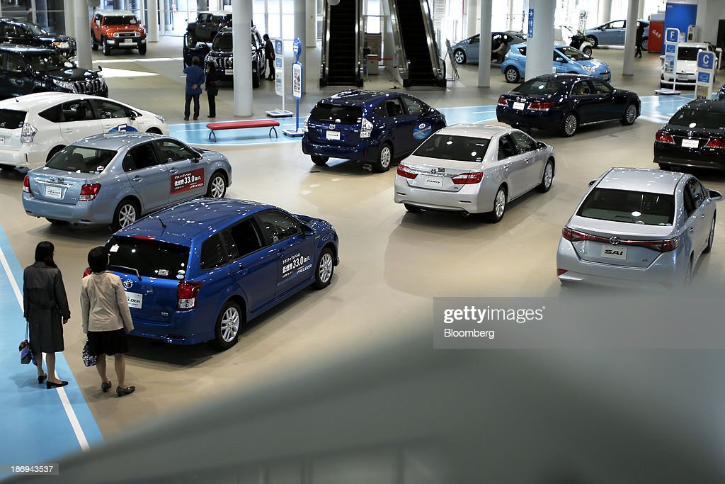 Toyota Motor Corp. vehicles stand on display at the company's showroom in Tokyo, Japan, on Tuesday, Nov. 5, 2013. Toyota, the world's largest automaker, will probably deliver record semiannual profit when it reports earnings tomorrow, as the weaker yen bolsters the value of Japanese cars sold overseas. Photographer: Kiyoshi Ota/Bloomberg via Getty Images