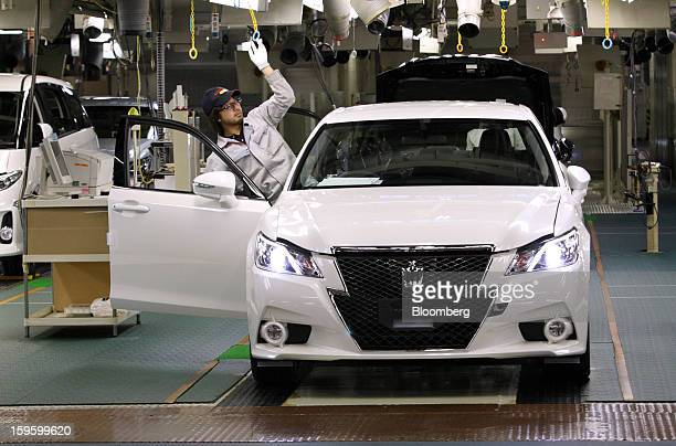 A Toyota Motor Corp worker makes a final inspection of the company's Crown sedan at its Motomachi plant in Toyota City Aichi Prefecture Japan on...