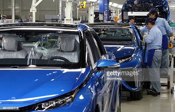 Toyota Motor Corp workers assemble a Mirai fuelcell vehicle on the production line of the company's Motomachi plant in Toyota Aichi Prefecture Japan...