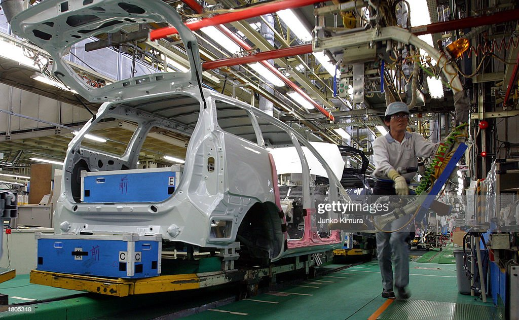 Toyota Motor Corporation Employees Assemble A Car At The