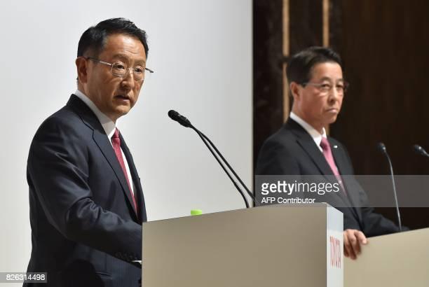 Toyota Motor Corporation President Akio Toyoda answers questions as Mazda Motor Corporation President and CEO Masamichi Kogai looks on during their...