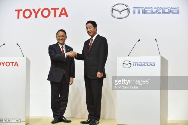 Toyota Motor Corporation President Akio Toyoda shakes hands with Mazda Motor Corporation President and CEO Masamichi Kogai prior to their joint press...