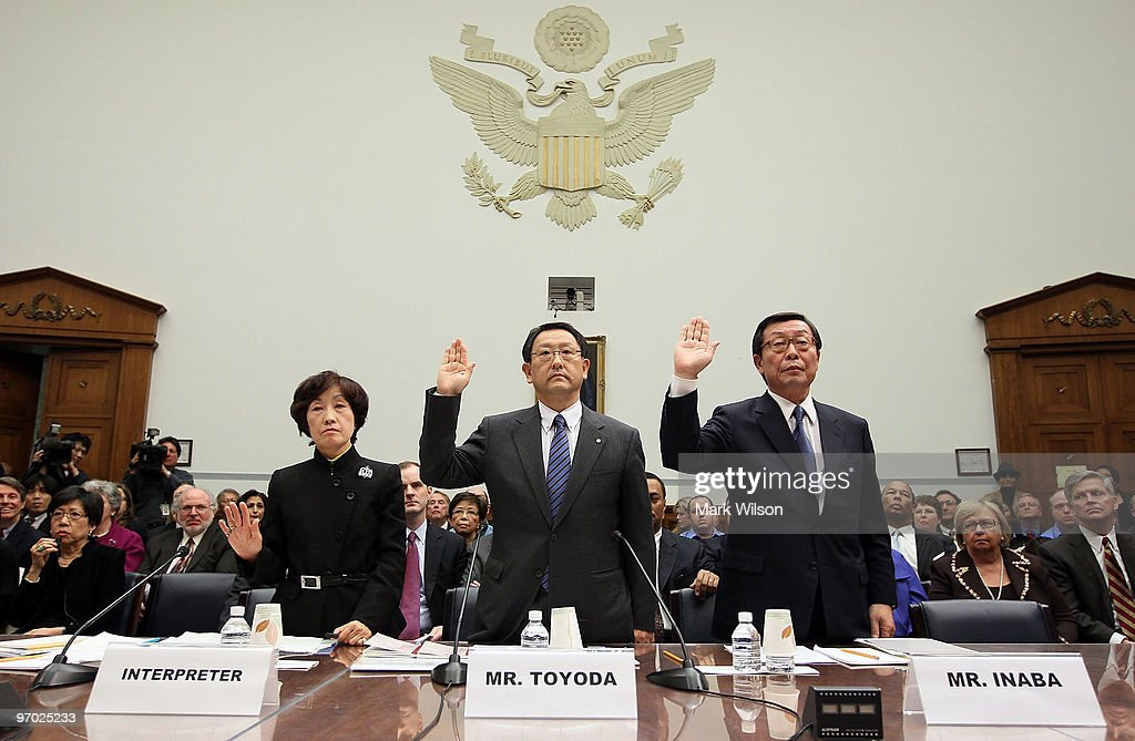 Toyota Motor Corporation President and CEO <a gi-track='captionPersonalityLinkClicked' href=/galleries/search?phrase=Akio+Toyoda&family=editorial&specificpeople=2334399 ng-click='$event.stopPropagation()'>Akio Toyoda</a> (C) and Toyota Motor North America CEO Yoshiumi Inaba (R) are sworn in with their interpreter (L) before the House Oversight and Government Reform Committee hearing on Capitol Hill February 24, 2010 in Washington DC. The committee is hearing testimony on the recall of millions of Toyota vehicles due to reports of malfunctioning gas pedals. Also pictured is Rep. Darrell Issa (R-CA) (R).