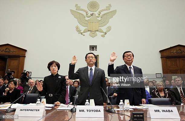 Toyota Motor Corporation President and CEO Akio Toyoda and Toyota Motor North America CEO Yoshiumi Inaba are sworn in with their interpreter before...