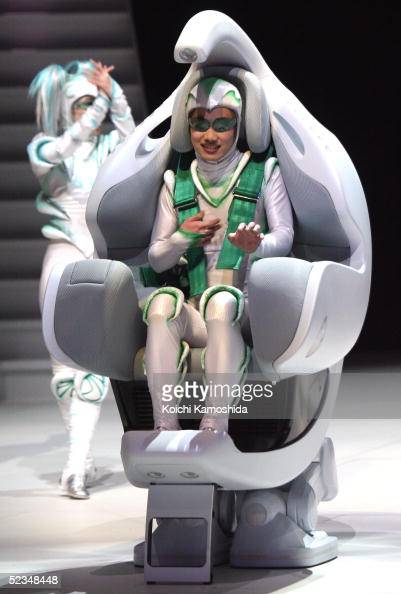Toyota Motor Corporation's humancontrolled walking robot 'ifoot' is operated during a preview for the Toyota Group pavilion at the 2005 World...