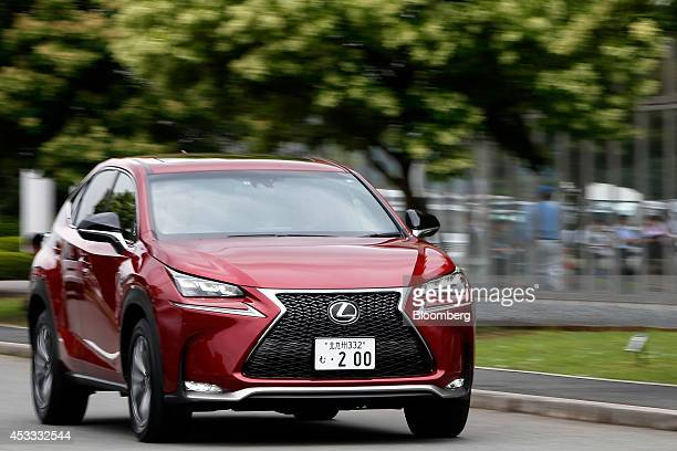 A Toyota Motor Corp's Lexus NX 200t crossover sportutility vehicle is driven during a test drive for a media preview at the Toyota Motor Kyushu Inc...