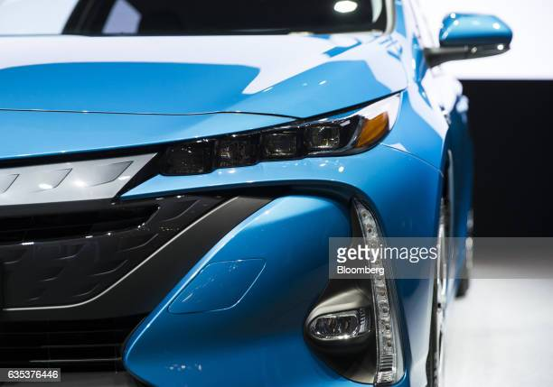Toyota Motor Corp's new Prius plugin hybrid vehicle known as Prius Prime in the US is displayed at its sales launch at the National Museum of...