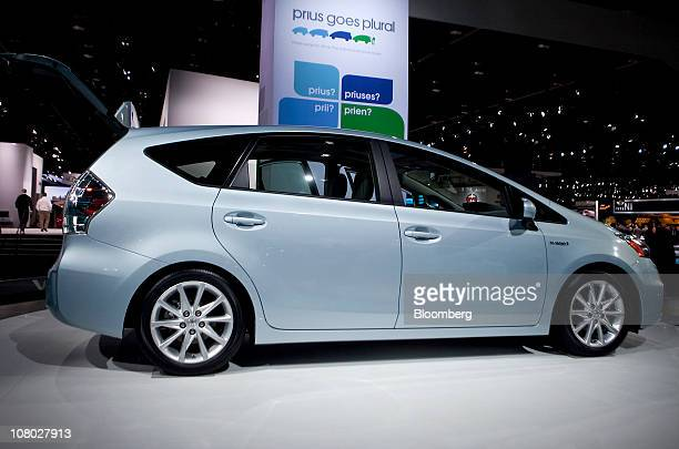 Toyota Motor Corp's Prius V hybrid wagon sits on display during the North American International Auto Show in Detroit Michigan US on Wednesday Jan 12...