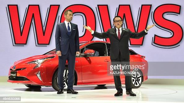 Toyota Motor president Akio Toyoda delivers a speech in front of the company's next generation hybrid vehicle Prius while special guest baseball star...