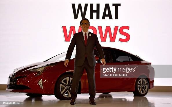 Toyota Motor president Akio Toyoda delivers a speech with the company's next generation hybrid vehicle Prius during a press preview at the Tokyo...