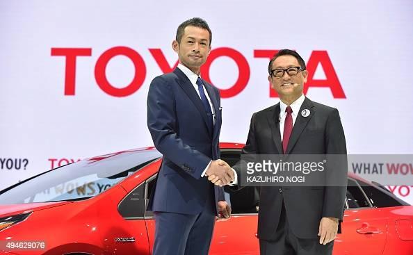 Toyota Motor president Akio Toyoda shakes hands with special guest baseball star Ichiro Suzuki who plays for Major League Baseball 's Miami Marlins...