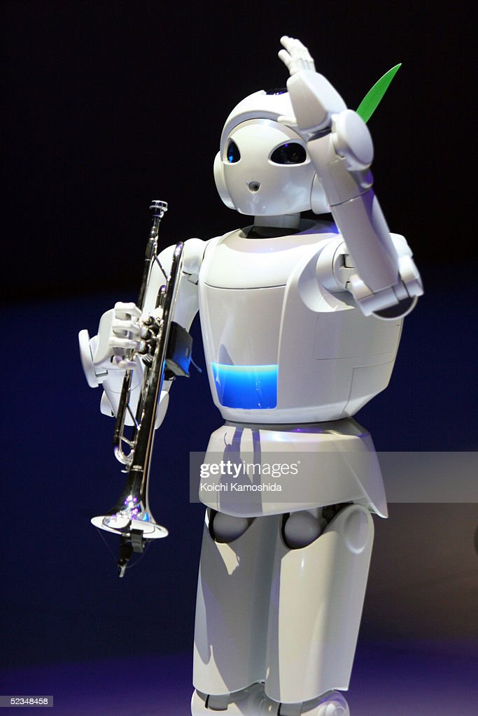Toyota Motor's musicplaying robot holds a trumpet during a preview for the Toyota Group pavilion at the 2005 World Exposition AIchi March 10 2005 at...