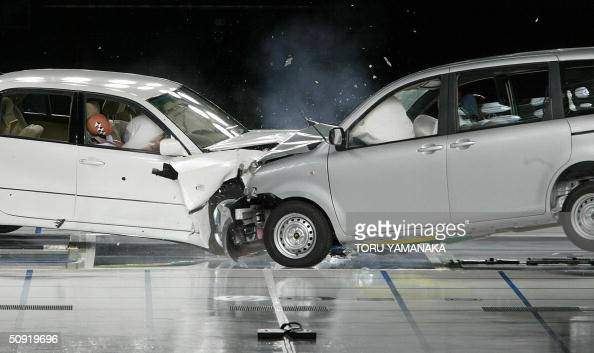 Toyota Motor's passenger car Celsior and Sienta crash into each other during an offset collision test at its Higashifuji Technical Center in Susono...