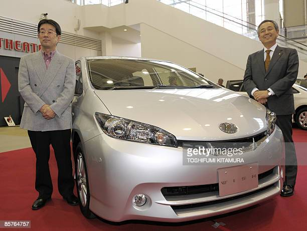 Toyota Motors Senior Managing Director Yoichiro Ichimaru and Chief Engineer Toshihiro Oi stand beside the company's new 'Wish' compact mini van...