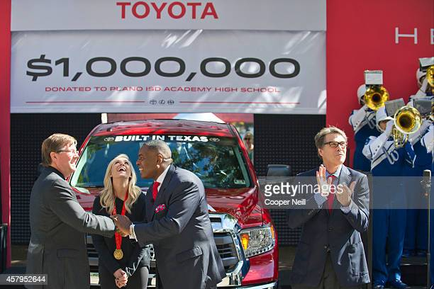 Toyota North America CEO Jim Lentz Olympic gold medalist Nastia Liukin Plano Mayor Harry LaRosiliere and Texas Governor Rick Perry announce a $1000...