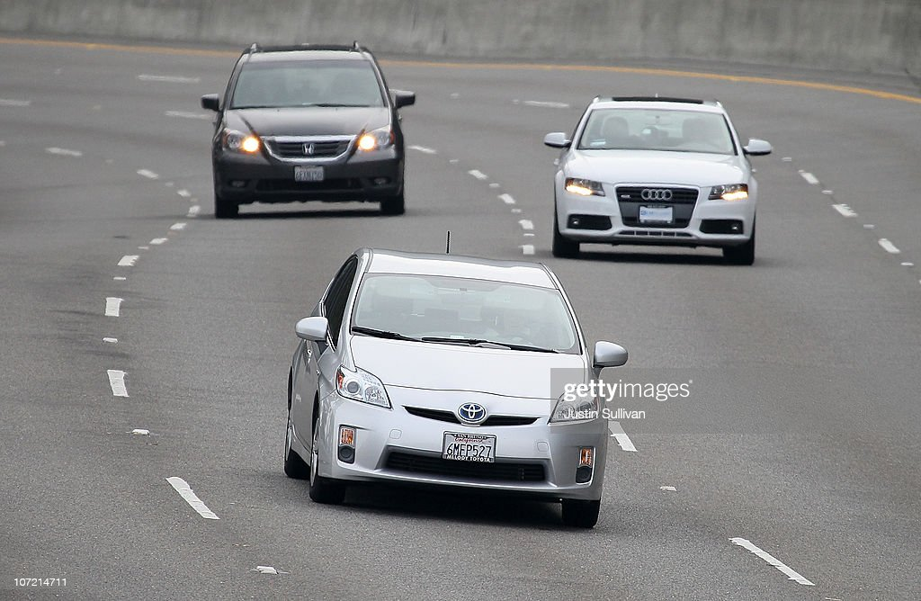 A Toyota Prius (C) drives along highway 101 on November 30, 2010 in Sausalito, California. Toyota Motor Corp. is issuing a recall for 650,000 Toyota Prius hybrids to repair cooling pumps that could fail and cause the vehicle to overheat and lose power.