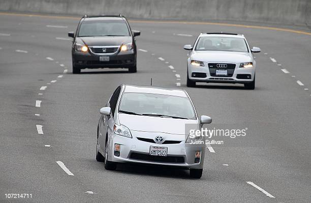 Toyota Prius drives along highway 101 on November 30 2010 in Sausalito California Toyota Motor Corp is issuing a recall for 650000 Toyota Prius...
