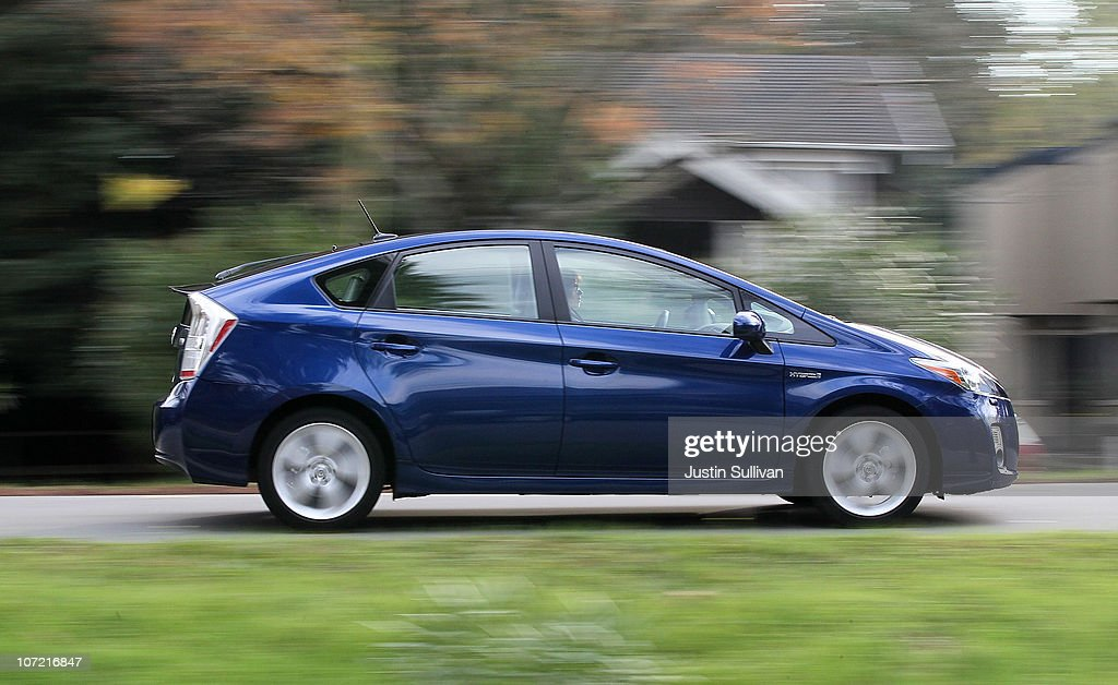 A Toyota Prius drives in a residential neighborhood on November 30, 2010 in San Anselmo, California. Toyota Motor Corp. is issuing a recall for 650,000 Toyota Prius hybrids to repair cooling pumps that could fail and cause the vehicle to overheat and lose power.
