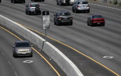 Toyota Prius with a California 'clean air vehicle' sticker drives in the carpool lane on highway 101 on May 6 2011 in San Rafael California The...