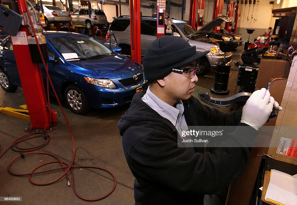 Toyota service technician Tungyio Saelee performs a recall repair on an accelerator pedal from a brand new Toyota Corolla at City Toyota February 5...