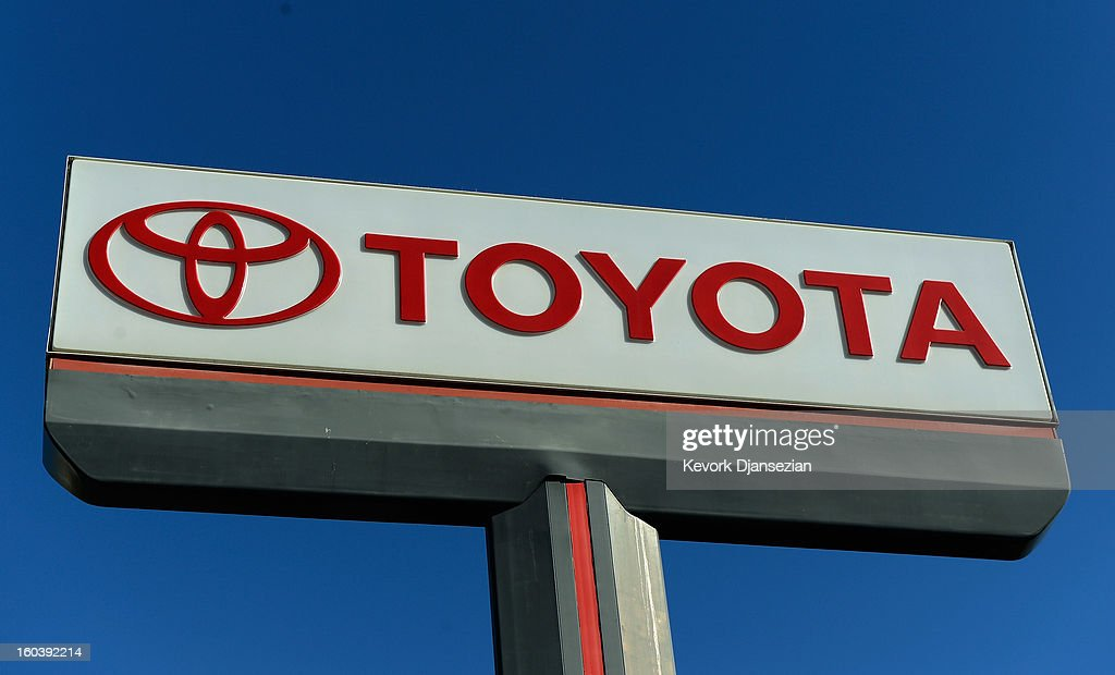 A Toyota sign stands at a dealership on January 30, 2013 in Los Angeles, California. Toyota is recalling more than one million vehicles sold in the United States over faulty airbags and windshield wipers.