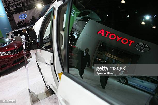 Toyota vehicle is displayed in the window at the New York International Auto Show during the press preview April 1 2010 in New York City The show...