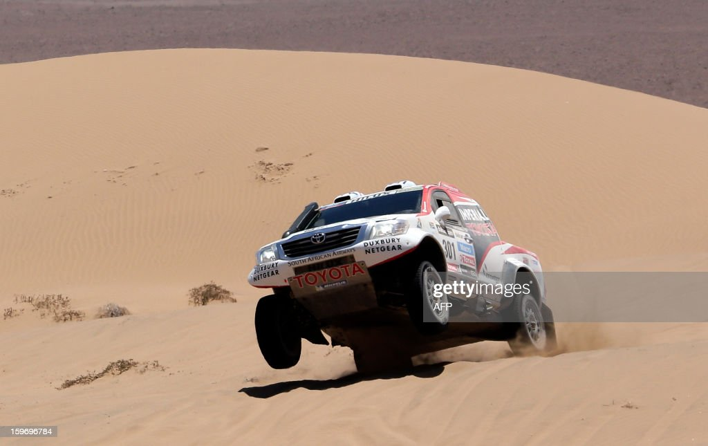 Toyota's driver Giniel De Villiers of South Africa and co-driver Dirk Von Zitzewitz of Germany compete during the Stage 13 of the 2013 Dakar Rally between Copiapo and La Serena, in Chile, on January 18, 2013. The rally is taking place in Peru, Argentina and Chile from January 5 to 20. AFP PHOTO / JACKY NAEGELEN / POOL