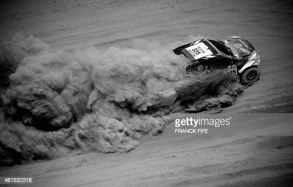 Toyota's driver Yazeed Alrajhi of Saudi Arabia and codriver Timo Gottschalk of Germany compete during the Stage 9 of the Dakar 2015 between Iquique...