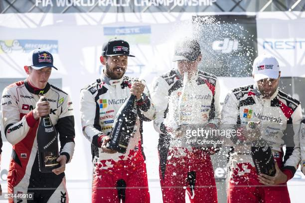 Toyota's Finnish driver Esapekka Lappi and copilot Janne Färm celebrate on podium after winning the Neste Rally Finland 2017 in Jyväskylä central...