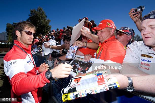 Toyota's Jarno Trulli signs autographs for fans before the Australian Grand Prix at Albert Park Melbourne Australia