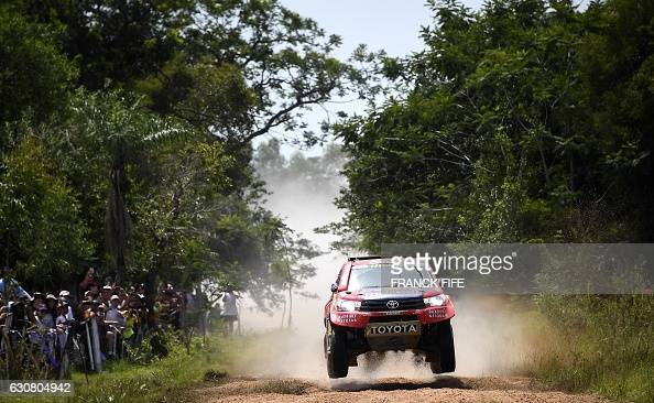 TOPSHOT Toyota's pilot Nasser AlAttiyah of Qatar and his copilot Matthieu Baumel of France compete during the 2017 Dakar Rally Stage 1 between...