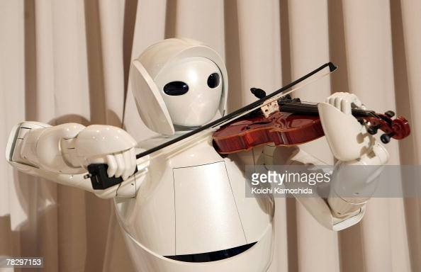 Toyota's violinplaying robot plays at Universal Design Showcase on December 62007 in Tokyo Japan The robot which has 17 joints in both arms uses...