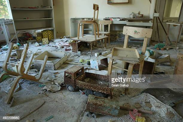 Toys and children's chairs lie in the 'Zlataya ribka' abandoned kindergarten on September 30 2015 in Pripyat Ukraine Pripyat lies only a few...