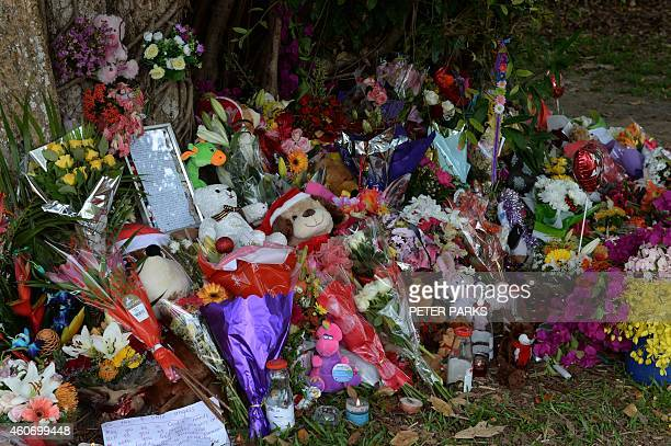 Toys and flowers are seen on December 20 2014 at the scene where eight children ranging from babies to teenagers were found dead in a house in the...