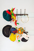 Toys and hats hanging from hook in kindergarten