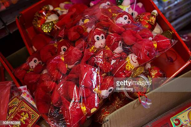 Toys featuring monkey designs on sale for Lunar New Year sit in a box at a market stall in the Sham Shui Po district of Hong Kong China on Thursday...